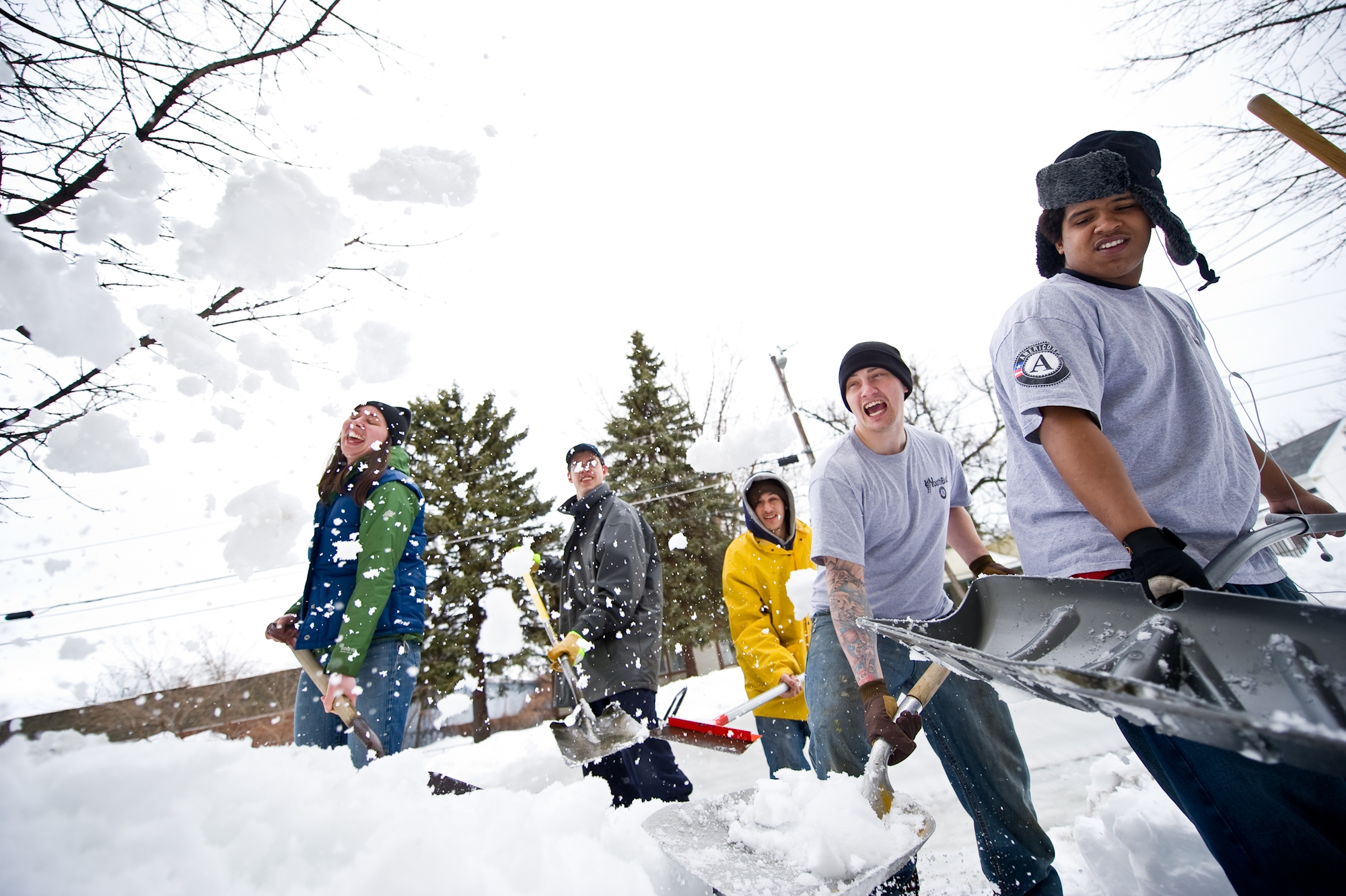 Colleen Kent and YouthBuild students lend a hand during an especially snowy winter.